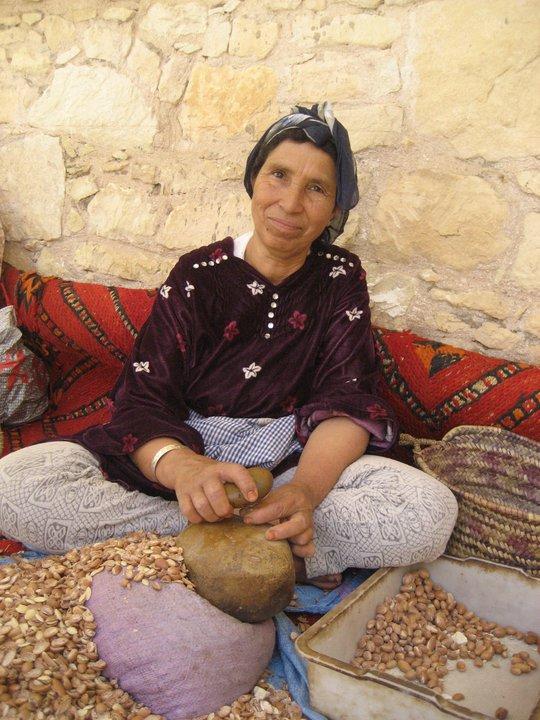Berber woman crushing Argan seeds, Morocco